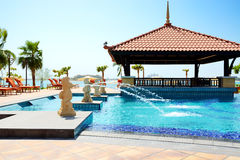 The swimming pool near beach in Thai style hotel Stock Images