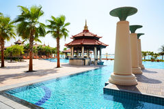 The swimming pool near beach in Thai style hotel Royalty Free Stock Image