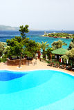Swimming pool near beach at Turkish resort Stock Photo