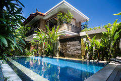 Swimming pool near the house. Royalty Free Stock Photo