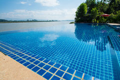 Swimming pool near Khong river with blue sky Royalty Free Stock Image