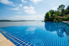 Swimming pool near Khong river with blue sky Royalty Free Stock Photos