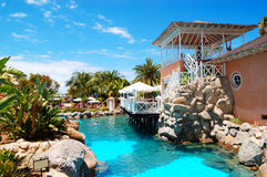 Swimming pool near open-air restaurant at luxury hotel Royalty Free Stock Images