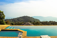 Swimming pool near the sea on mountains Koh Samui Stock Photos
