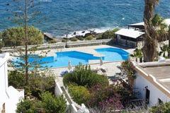 Swimming pool near the sea in Sunny day. The island of Crete Stock Image