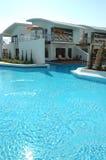 Swimming pool near villa at luxury hotel Stock Image