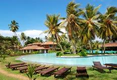 Swimming pool near villas at the popular hotel. Bentota, Sri Lanka Royalty Free Stock Photo