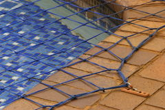 Swimming pool net. Close up view of a swimming pool net, used to prevent accidental drowning Stock Image