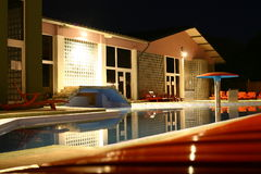 Swimming pool at night. Hotel swimming pool at night royalty free stock photo
