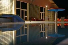 Swimming pool at night. Hotel swimming pool at night royalty free stock photos