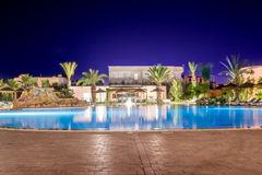 Swimming pool at night Royalty Free Stock Photos