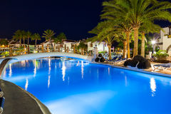 Swimming pool at night. Vacation background Royalty Free Stock Photo