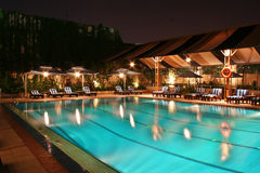 Swimming Pool at Night Stock Images