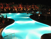 Swimming pool in the night. A night vision of a big swimming pool in a red sea village Royalty Free Stock Photo