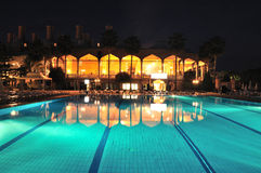 Swimming pool in night illumination Royalty Free Stock Photos