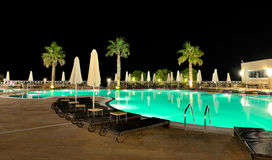 Swimming pool in night illumination Royalty Free Stock Images