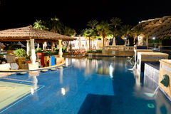 Swimming pool in night illumination at the luxury hotel Royalty Free Stock Photos
