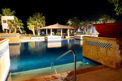 Swimming pool in night illumination at the luxury hotel Stock Images