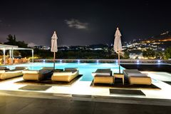 Swimming pool in night illumination at the luxury hotel Royalty Free Stock Images