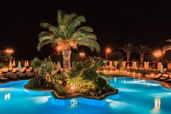 Swimming pool in night illumination Royalty Free Stock Image