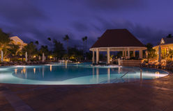 Swimming pool in night at a local resort Stock Images