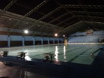 Swimming pool at night. Olympic size pool in the evening at Marikina Sports Center, Philippines stock images