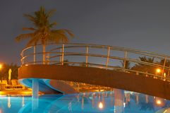 Swimming pool, night and palm trees Royalty Free Stock Image