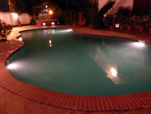 Swimming pool by night Royalty Free Stock Image