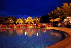 Swimming pool at night. In sanya, China, a hotel swimming pool at night with light and refelction Stock Images
