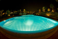 Swimming pool night scene Stock Images