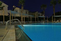 Swimming pool night scene Stock Photos