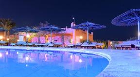 Swimming pool at night Royalty Free Stock Photo