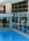 Swimming pool. Night shot of a detail of a swimming pool and the architectural structure of a modern bar Stock Photos