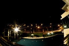 Swimming pool in night time at clubhouse village. Luxury of village Royalty Free Stock Photo