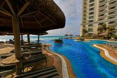 Swimming Pool Beside Nipa Hut Royalty Free Stock Photography