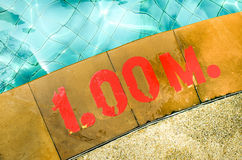 Swimming pool with Number 1.00 on ground at hotel. Outdoor view Stock Photo
