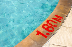 Swimming pool with Number 1.60 on ground at hotel. Outdoor view Royalty Free Stock Photo
