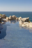 Swimming pool by ocean royalty free stock images