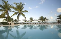 Swimming pool by the ocean Stock Photos