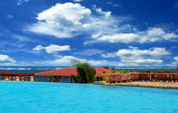 Swimming pool and ocean in Kenya Royalty Free Stock Photos