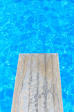 Swimming pool with old wooden diving board Royalty Free Stock Images