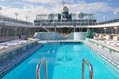 Swimming pool onboard Crystal Serenity cruise ship open deck Royalty Free Stock Photo