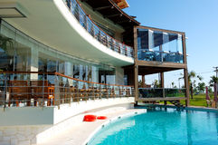 Swimming pool and outdoor restaurant Stock Images