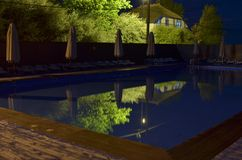Swimming pool outdoors at night royalty free stock photo
