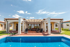 Swimming pool outside luxury home Stock Photography