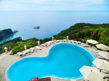 Swimming-pool over blue lagoon coast landscape ionian sea on Cor. Swimmong-pool over blue lagoon beach coast in the ionian sea landscape on Corfu island royalty free stock photo