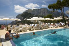 Swimming pool overlooking City of Capri, an Italian island off the Sorrentine Peninsula on the south side of Gulf of Naples, in th Stock Image