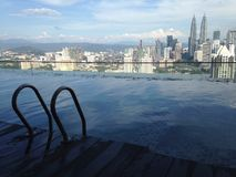 Swimming pool overlooking Kuala Lumpur Royalty Free Stock Images