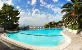 Swimming Pool Palm Garden Luxury Hotel. Perspective - Large swimming pool and palm trees in garden. Luxury Hotel Royal Sun. Chania Crete Greece Stock Image
