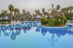 Swimming pool, palm trees, park recreation area Royalty Free Stock Photography